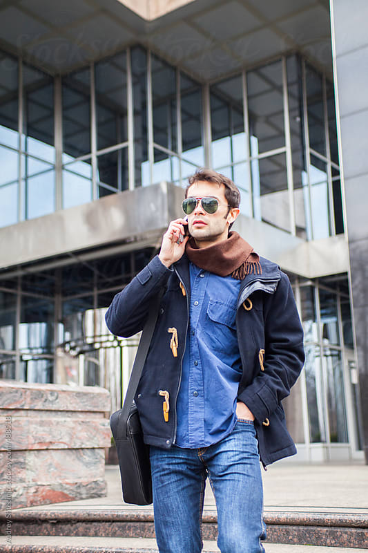 Young modern guy in front of the corporate  building. by Audrey Shtecinjo for Stocksy United