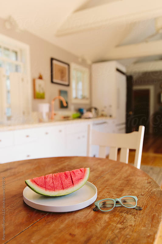 Watermelon on Table by Raymond Forbes LLC for Stocksy United
