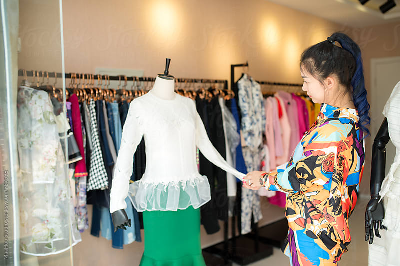 Young woman in her clothing store by Maa Hoo for Stocksy United