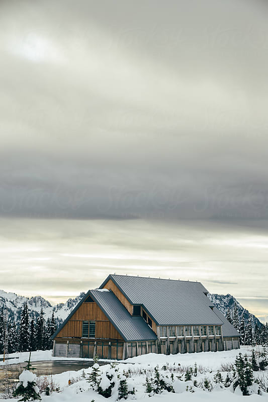 Mountain Lodge Surrounded By Snowy Forest In Winter by Luke Mattson for Stocksy United
