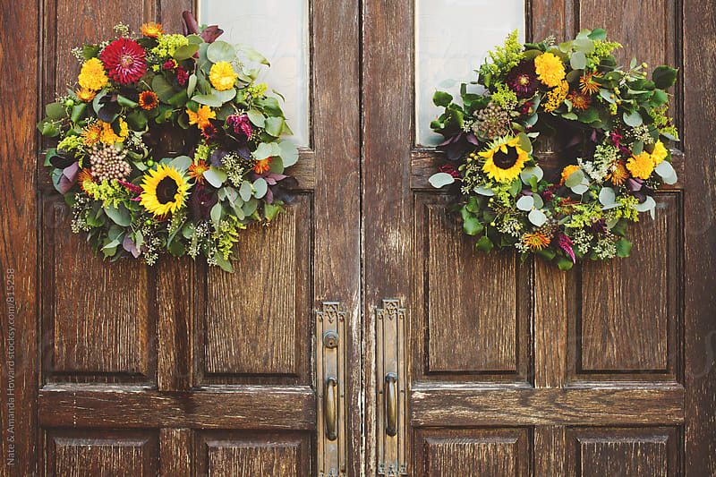 door wreaths by Nate & Amanda Howard for Stocksy United