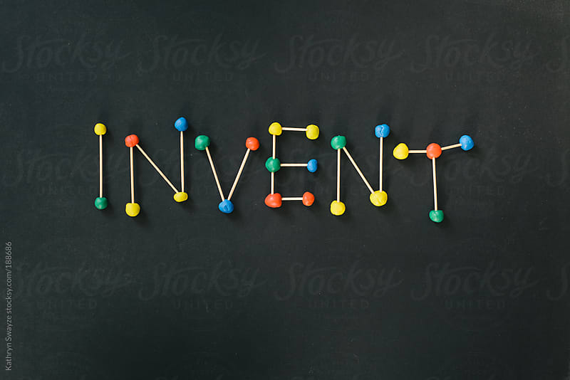 Invent is spelled out with balls of modeling clay and toothpicks by Kathryn Swayze for Stocksy United