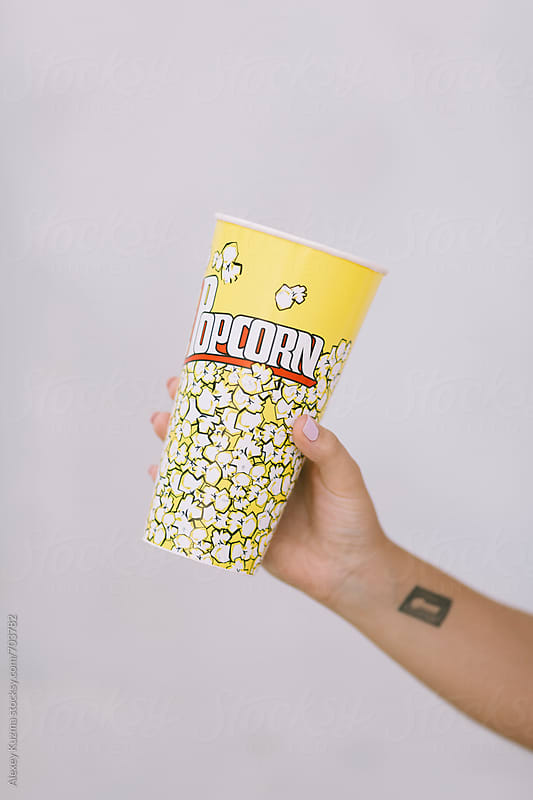 hand with popcorn by Alexey Kuzma for Stocksy United