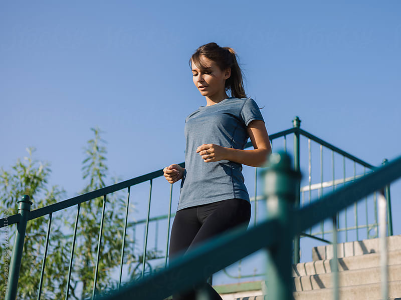 Woman jogging by Milles Studio for Stocksy United