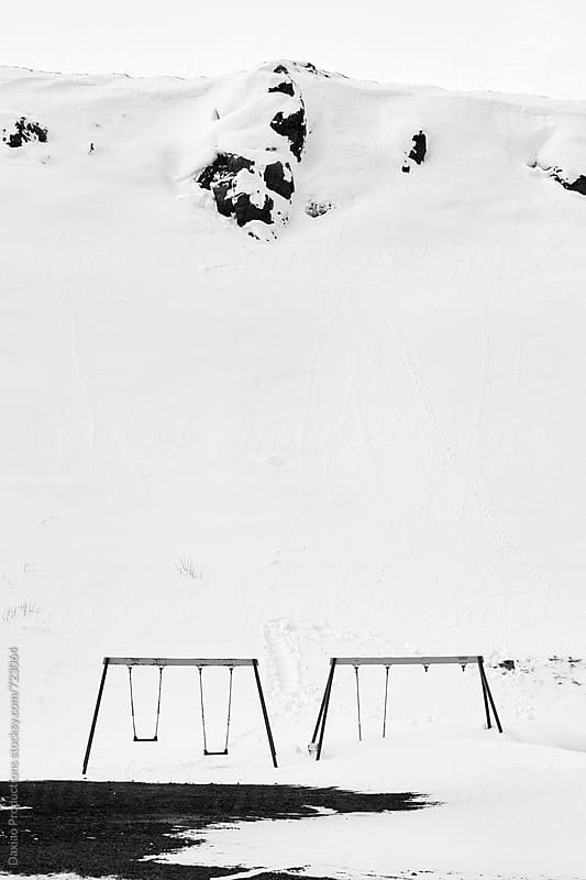Empty playground in snow by Daxiao Productions for Stocksy United