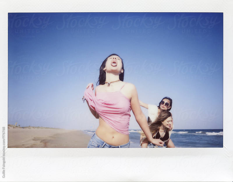 Young crazy girlfriends having fun on beach by Guille Faingold for Stocksy United