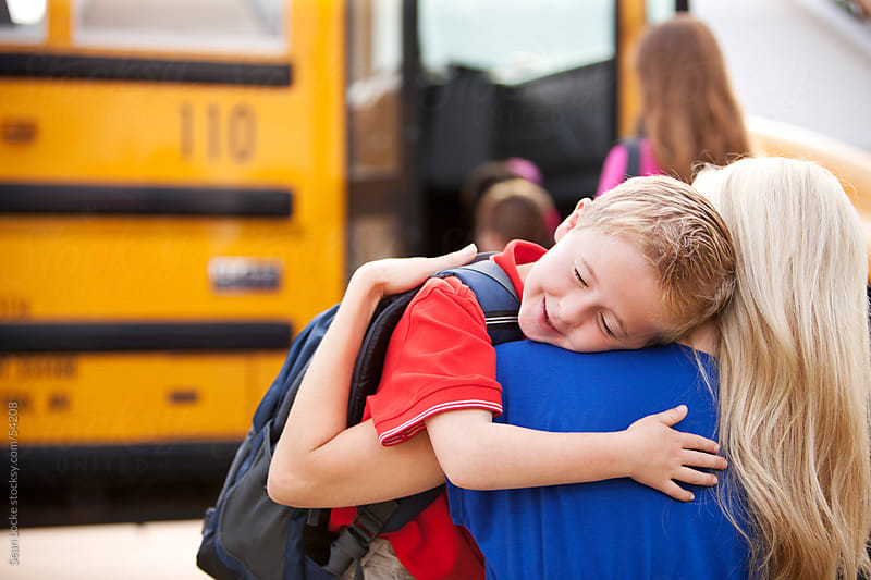 School Bus: Boy Hugs Mother Before School by Sean Locke for Stocksy United