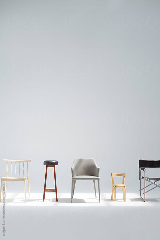 Group of different chairs and stools by Miquel Llonch for Stocksy United