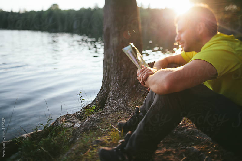 Adventurer reading a Map by Good Vibrations Images for Stocksy United