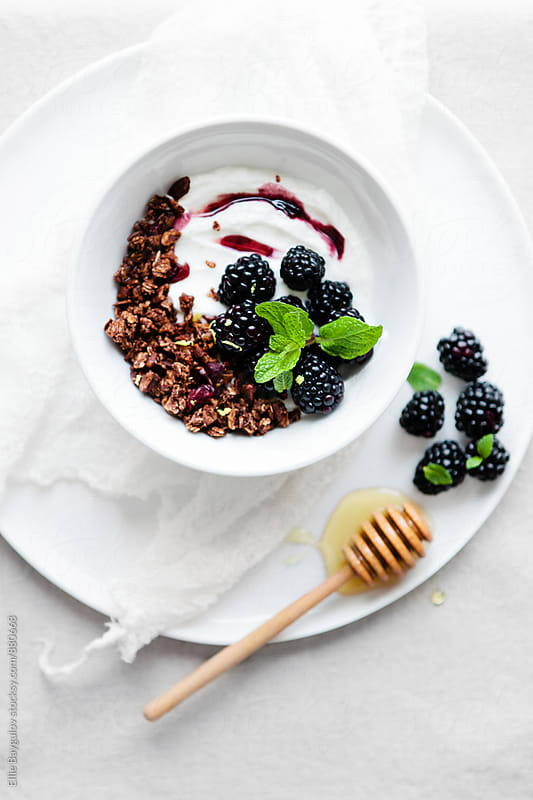 Chocolate granola with greek yogurt and berries by Ellie Baygulov for Stocksy United