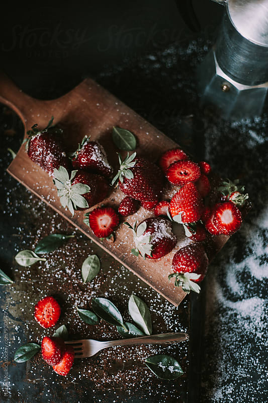 Strawberries on a cutting board by Natasa Kukic for Stocksy United
