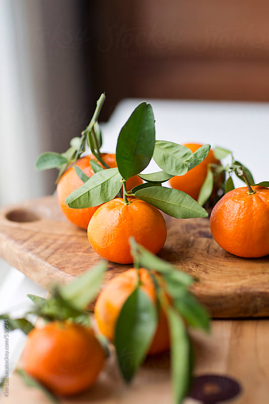 Clementines on Cutting Board by Kim Lucian for Stocksy United
