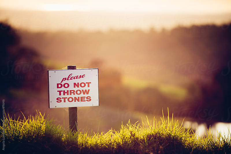 Sign in a country setting at sunset by Angela Lumsden for Stocksy United