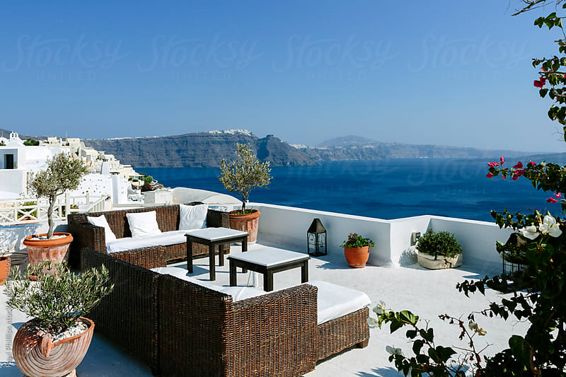Terrace with a view to the Caldera of Santorini by Paul Phillips for Stocksy United