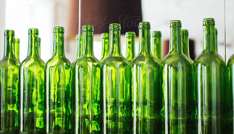 Green bottles in a restaurant.  by BONNINSTUDIO for Stocksy United