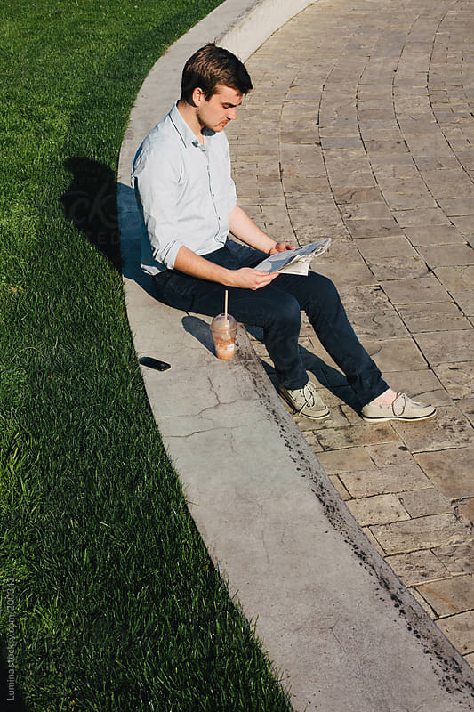 Man Reading the Newspaper by Lumina for Stocksy United
