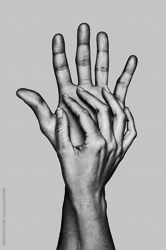 Detail of the hands of a couple. Black and white. by BONNINSTUDIO for Stocksy United