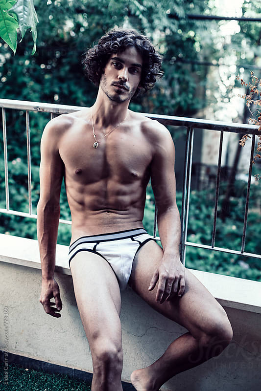 Man in Underwear at Home by Eldad Carin for Stocksy United