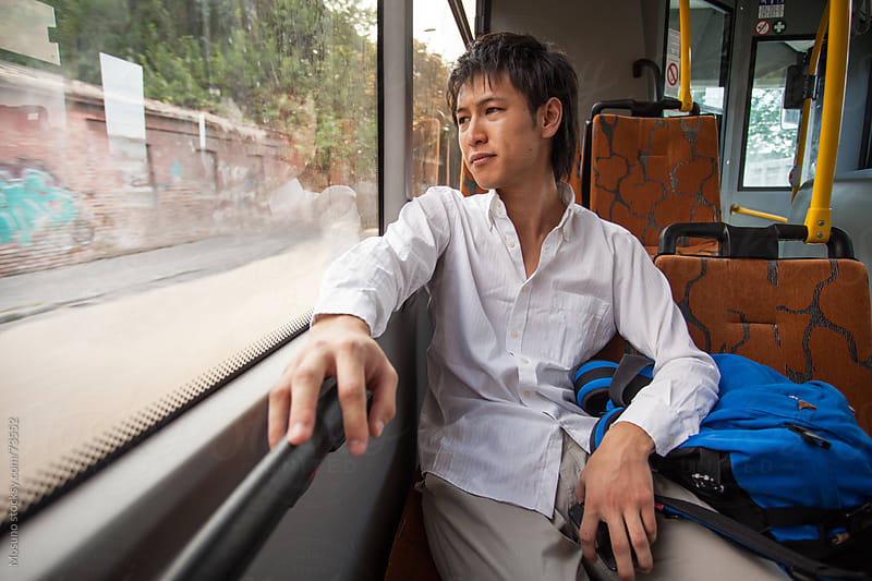 Young Student Riding a Bus by Mosuno for Stocksy United