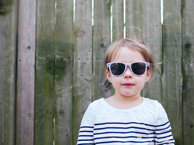 child wearing sunglasses by Meaghan Curry for Stocksy United