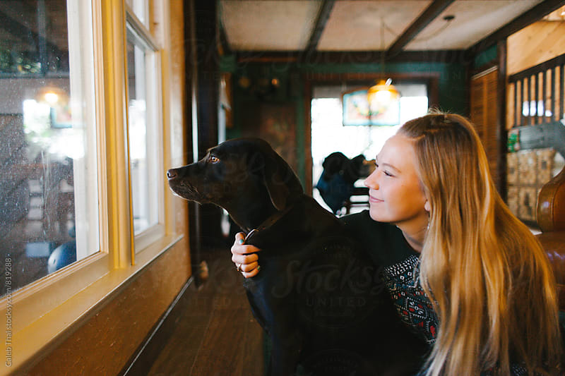 A girl and her dog by Caleb Thal for Stocksy United