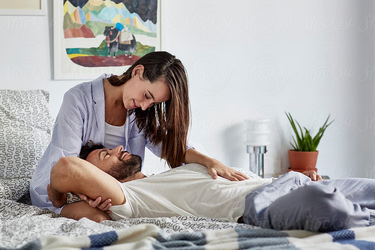Loving Man Lying On Woman's Lap In Bed by ALTO IMAGES - Romance ...