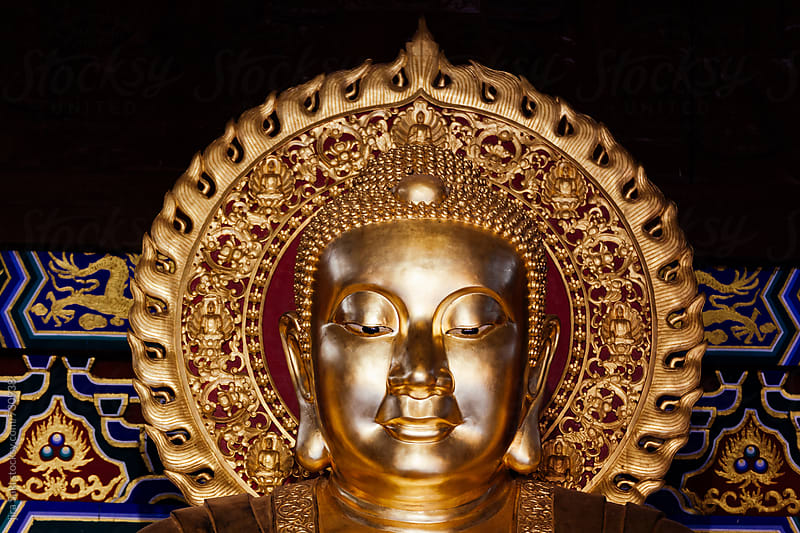 golden buddha by jira Saki for Stocksy United