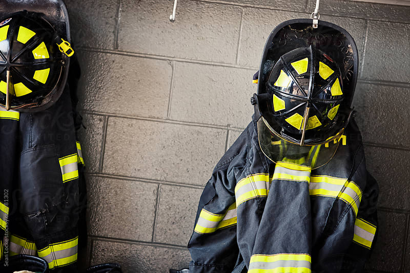 Firehouse: Helmets and Jackets Ready To Be Worn by Sean Locke for Stocksy United