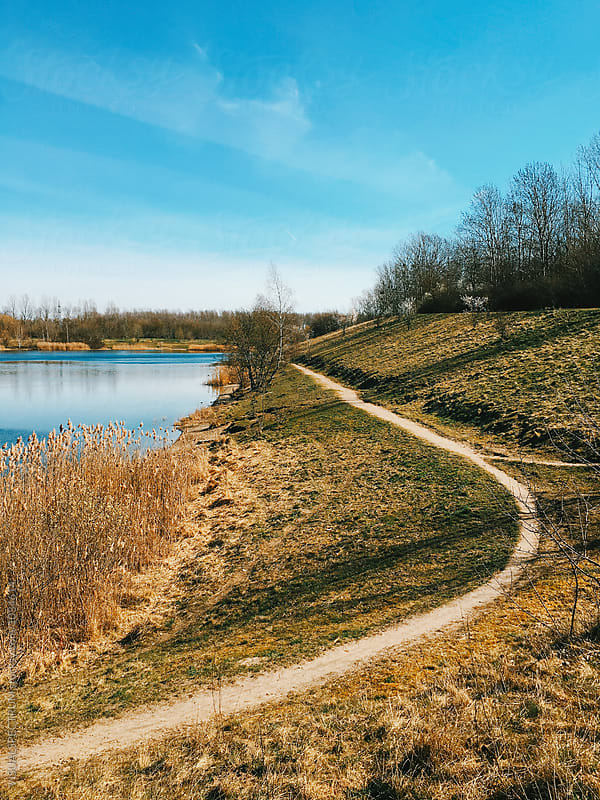 Path Along Pristine Lake on Spring Day by Julien L. Balmer for Stocksy United