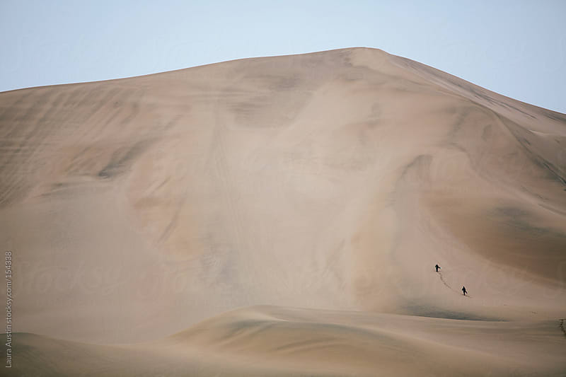 People Hiking Massive Sand Dune by Laura Austin for Stocksy United