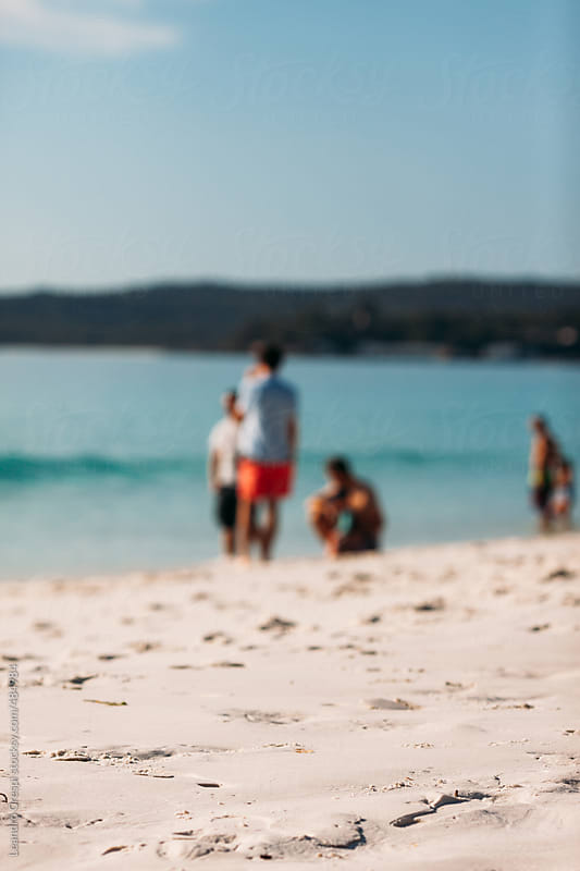 Out of focus scene, people at the beach by Leandro Crespi for Stocksy United