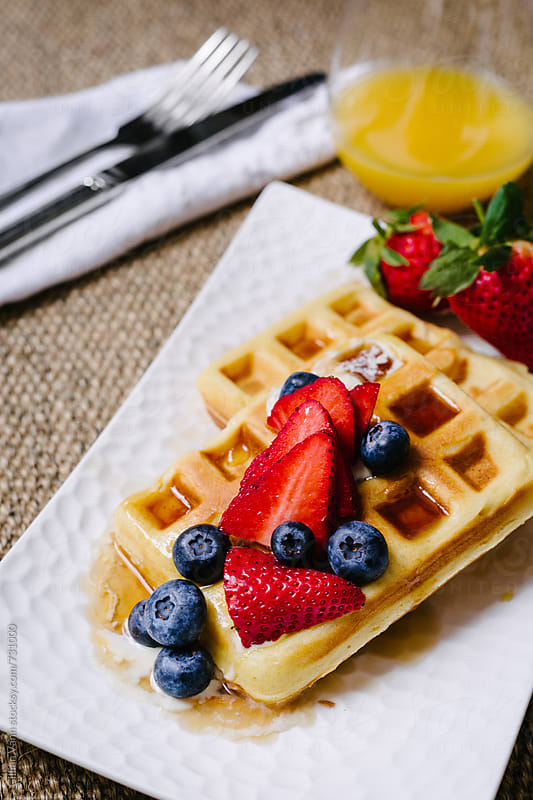 a breakfast of waffles by Gillian Vann for Stocksy United