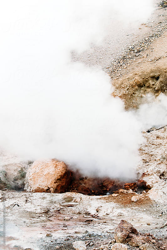 Steaming Fumarole On Rocky Landscape by Luke Mattson for Stocksy United