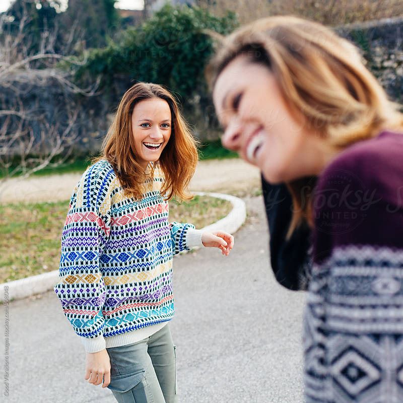 Two happy friends outdoors by Good Vibrations Images for Stocksy United