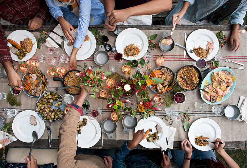 Overhead of People at Dinner Party by Jill Chen for Stocksy United