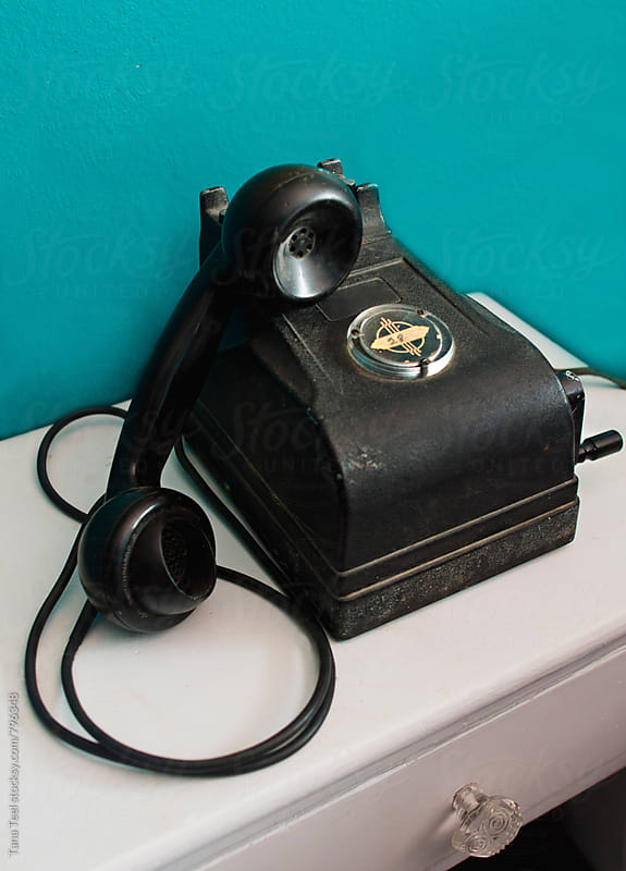 vintage telephone  by Tana Teel for Stocksy United