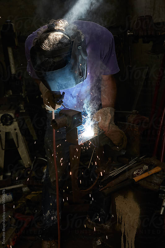 Metal worker in studio working  by Trinette Reed for Stocksy United