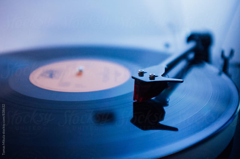 Gramophone playing gramophone vinyl record by Tomas Mikula for Stocksy United