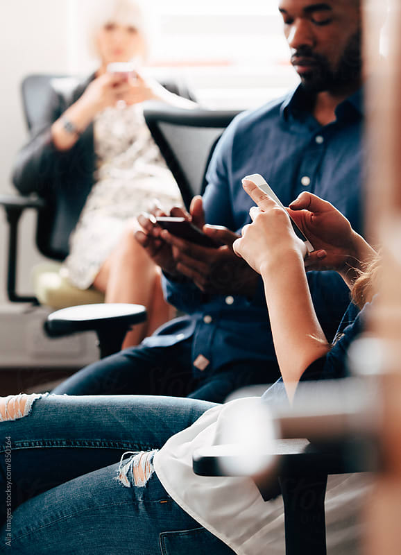 Group of people using smart phones by Aila Images for Stocksy United