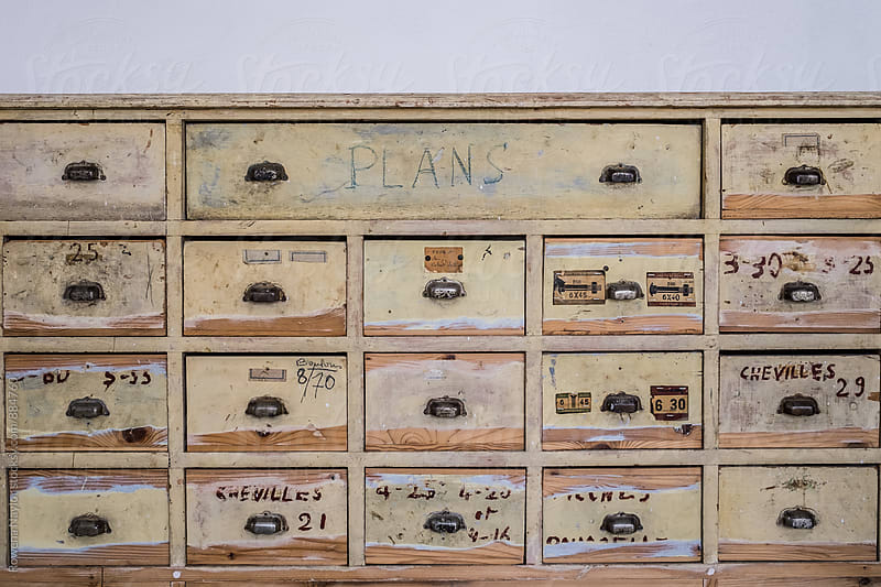 Vintage industrial storage drawers used as furniture by Rowena Naylor for Stocksy United