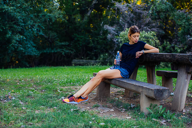 Female Runner Resting in the Park by Mosuno for Stocksy United
