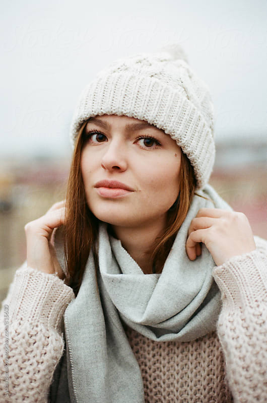 Winter portrait of young woman by Lyuba Burakova for Stocksy United