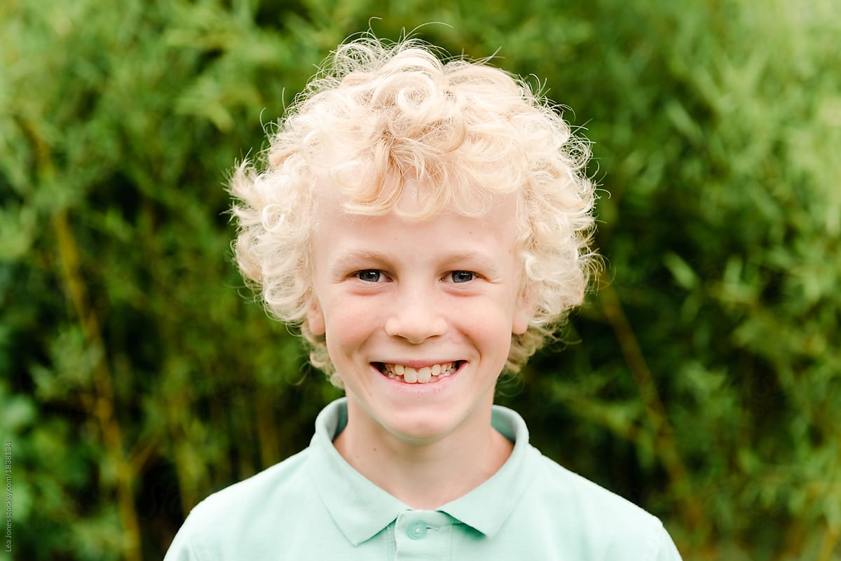 Boy With Curly Blonde Hair Stocksy United