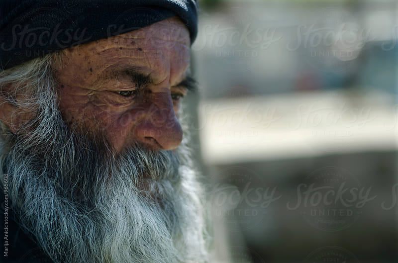 Old fisherman by Marija Anicic for Stocksy United