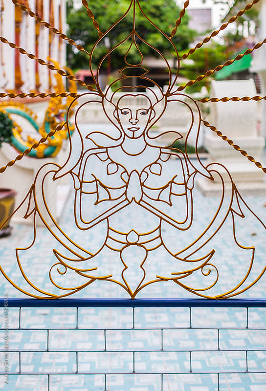 Ornament on fence at the entrance of buddhist temple. by Marko Milanovic for Stocksy United