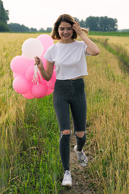 Stylish teen girl with pink balloons by Danil Nevsky for Stocksy United