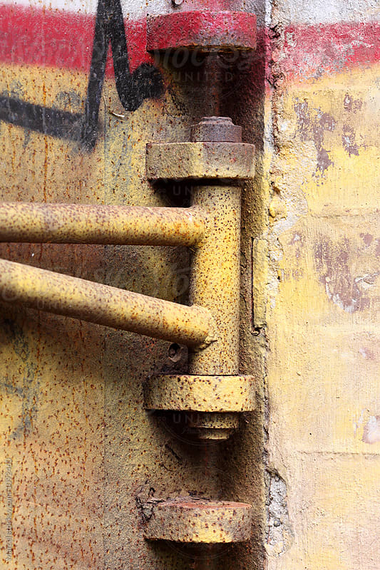 Metal hinge covered in graffiti by Marcel for Stocksy United
