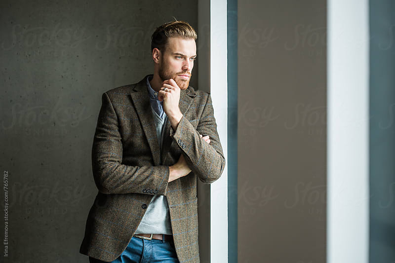 Handsome man in a smart casual outfit by Irina Efremova for Stocksy United