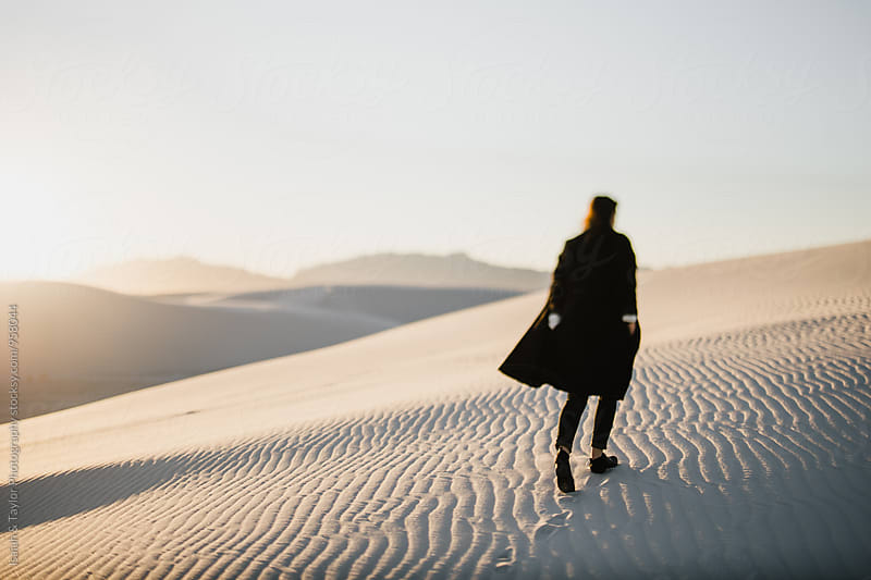Woman walking through desert by Isaiah & Taylor Photography for Stocksy United