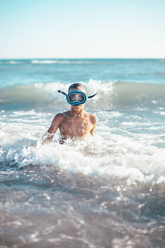 Scuba boy in the sea by Zocky for Stocksy United